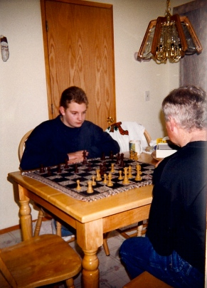 Joe playing chess with Jason