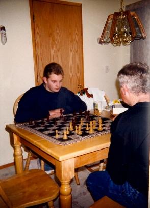 Joe playing chess with Jason