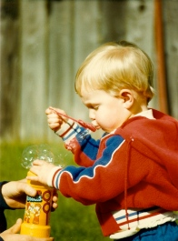 Playing bubbles in the yard